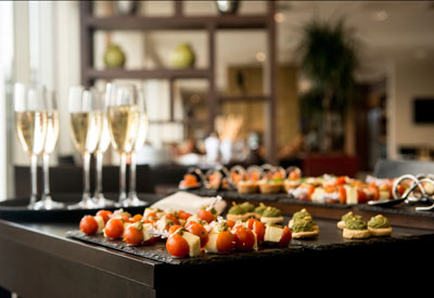 Heirloom's corporate catering offerings include appetizers and champagne