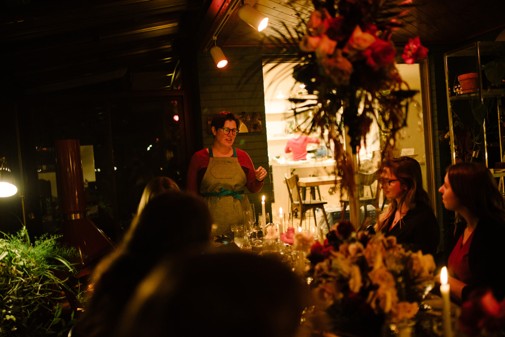 Heirloom Catering, Heirloom Cafe, and One Box Project Founder and CEO Michelle Garcia speaks to a group.